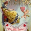 A vintage Valentines Day card with a woman pulling in a heart with string around it and cupid holding on — Stock Photo