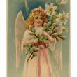 Stockfoto: Vintage Easter postcard of angel holding lilies