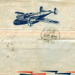 Vintage airmail envelope with a plane on it — Stock Photo #12092348