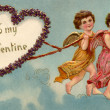 Stock Photo: Vintage To My Valentine card with two cherubs pulling heart