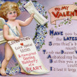 Stock Photo: Vintage Valentine postcard with cupid newspaper boy