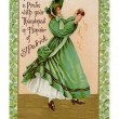 A vintage card of a woman peeling a pratie in honor of St Patrick — Stock Photo