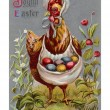 Stockfoto: Vintage Easter postcard of hen carrying colored Easter eggs