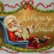 Vintage Christmas card of Santa Claus sitting in a chair and wreaths — Foto de Stock
