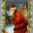 Stockfoto: Vintage Christmas card of SantClaus and sack full of gifts