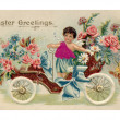 Stockfoto: Vintage Easter postcard with cherub riding antique car full of flowers