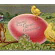 Vintage Easter postcard of chicks and rabbits on Easter egg — Stock Photo #12093420