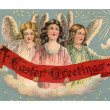 Stock Photo: Vintage Easter postcard of three angels holding banner