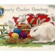 Vintage Easter postcard of lilies, white rabbit and Easter eggs — Stock Photo #12094235