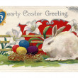 Stockfoto: Vintage Easter postcard of lilies, white rabbit and Easter eggs