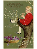 A vintage Easter postcard of a basket of violets and a boy playing a flute in a pussy willow tree — Stock Photo