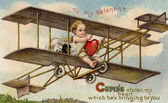A vintage Valentine card with cupid flying an airplane with a stolen heart — Stock Photo