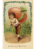 A vintage Easter postcard of a child with a large egg on his back — Stock Photo