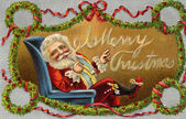 Vintage Christmas card of Santa Claus sitting in a chair and wreaths — Stock Photo