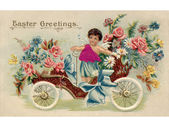 Um postal de páscoa vintage com um querubim montando um carro antigo cheio de flores — Foto Stock