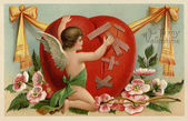 A vintage Valentines card with a cherub patching up a broken heart — Stock Photo