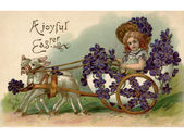 A vintage Easter postcard of a girl riding in a wagon full of violets being pulled by two lamb — Stock Photo