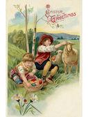 Cacciare una cartolina d'epoca di Pasqua di due ragazzi su un uovo di Pasqua — Foto Stock
