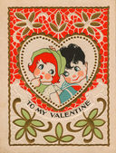 A vintage valentine with a boy and girl — Stock Photo