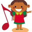 A young girl pointing holding a large musical note — Stock Photo