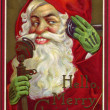 Vintage Christmas card of Santa Claus making a phone call — Stock Photo #12418972