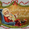 Vintage Christmas card of Santa Claus sitting in a chair and wre — Stock Photo