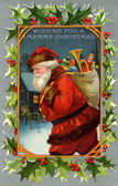 Vintage Christmas card of Santa Claus and a sack full of gifts — Stock Photo