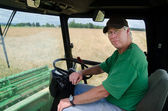 Farmer in tractor cab — Stock Photo