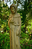 Mother Mary watches over garden — Stock Photo