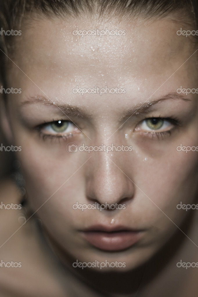Woman's face with drops of sweat — Stock Photo #11809528
