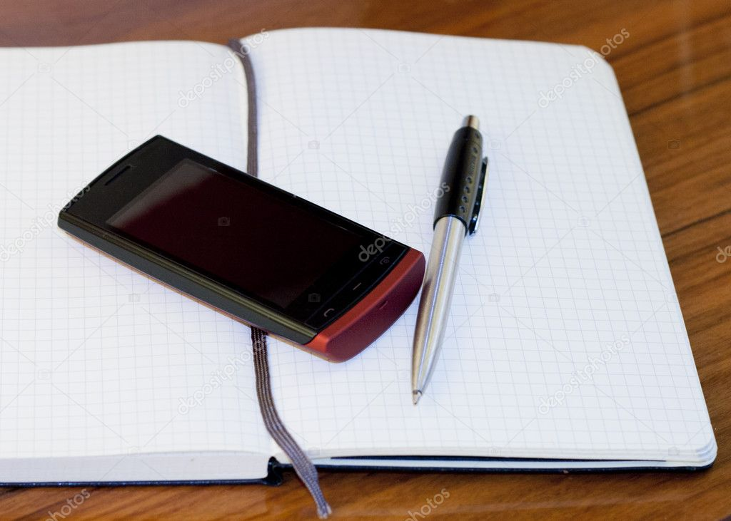 Open book, phone and pen on the table — Stock Photo #11921534
