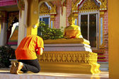 A boy pay respect to the Buddha image — Stock Photo