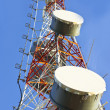 Telecommunication tower with antennas a blue sky. — Stock Photo