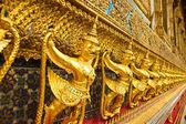 Golden garuda sculpture at Royal Palace in thai . — Stock Photo