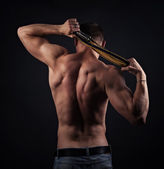 Muscular naked man from back — Stock Photo