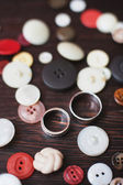 Wedding rings within buttons — Stock Photo