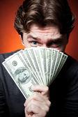 Człowiek z pieniędzy — Zdjęcie stockowe