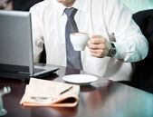 Businessman with a cup of coffee, close-up — Foto Stock