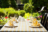 Outdoor restaurant dining table — Stock Photo