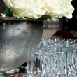 Stock Photo: White roses and glasses for champagne