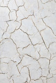 Decorative plaster with cracks — Stock Photo