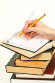 Books and hand with pencil on white — Stock Photo