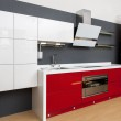 Modern kitchen interior with red decoration — Stock Photo