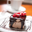 Cake with chocolate cream and berries — Stock Photo