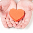 Red heart in the hands — Stock Photo #11817871