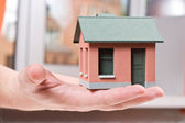Model of the small house in human hand — Stock Photo