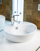 Modern bathroom sink in white ceramic — Stock Photo