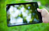 Close-up photo of tablet computer outdoor — Stock Photo