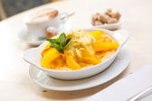 Semolina porridge with mango — Stock Photo