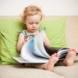 Baby girl reading a book — Stock Photo